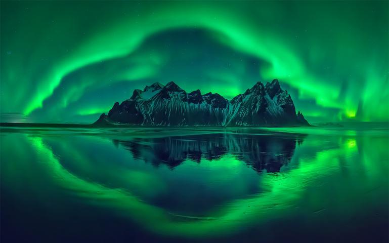 View of the mountains and aurora borealis